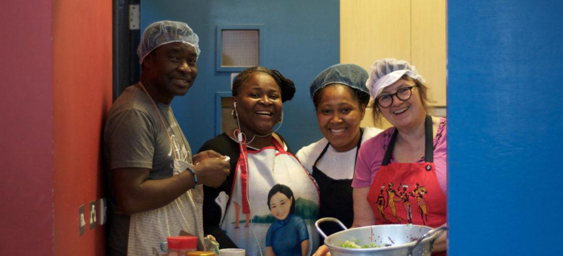 Volunteers cooking in the kitchen